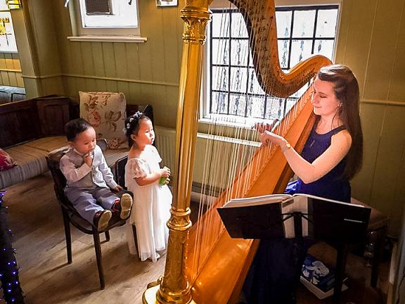 Zuzanna harpist at a wedding in London