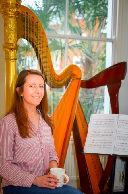 Zuzanna in her teaching studio with pedal harp and lever harp