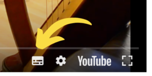Arrow showing where to turn on subtitles for the video